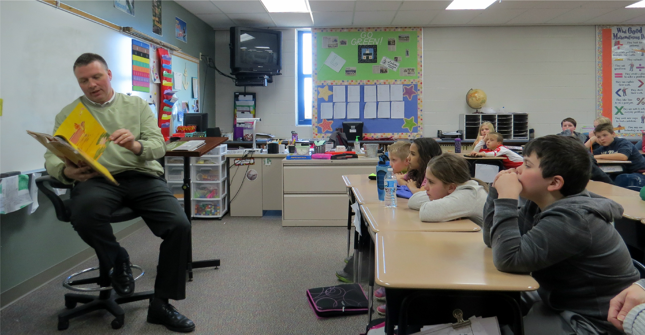 Mr. Keim reads to fourth graders